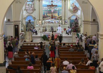 Parishioners take communion at Mass / Photo courtesy of the author
