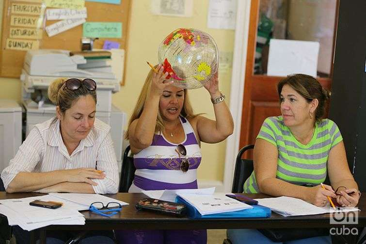 Students learn English at Kentucky Refugee Ministries. Most of the students in this classroom are from Cuba. The teacher, Katie Mills, tosses around a beach ball during class. Whoever catches the ball must answer her questions.