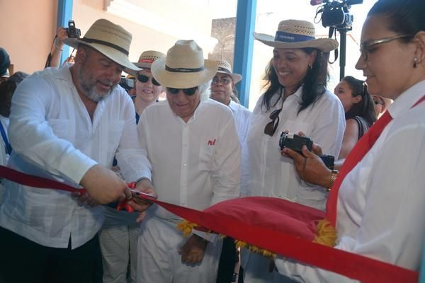 Minister Manuel Marrero (L), with the executive president of the Iberostar Group, Miguel Fluxà, cut the inaugural ribbon in the Plaza Colón Hotel, Gibara, Holguín. Photo: Juan Pablo Carreras.