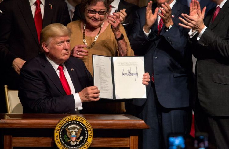 Donald Trump shows the presidential memorandum on the Cuba policy at the end of his speech at the Manuel Artime Theater of Little Havana, in Miami. Photo: Cristobal Herrera / EFE.