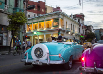 Tourists in vintage American convertibles in Havana. Photo: Desmond Boylan / AP.