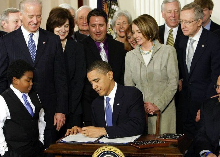 hoto taken on March 23, 2010 of then President Barack Obama signing in the White House in Washington the reform of the healthcare system. (AP Photo/J. Scott Applewhite)