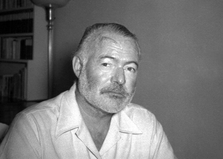 Novelist Ernest Hemingway poses at his home in San Francisco de Paula, near Havana, on August 21, 1950. Photo: AP.