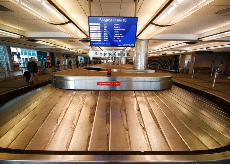 In this March 20, 2020 photo, an empty luggage carousel spins at Denver International Airport, Colorado. Photo: David Zalubowski / AP.