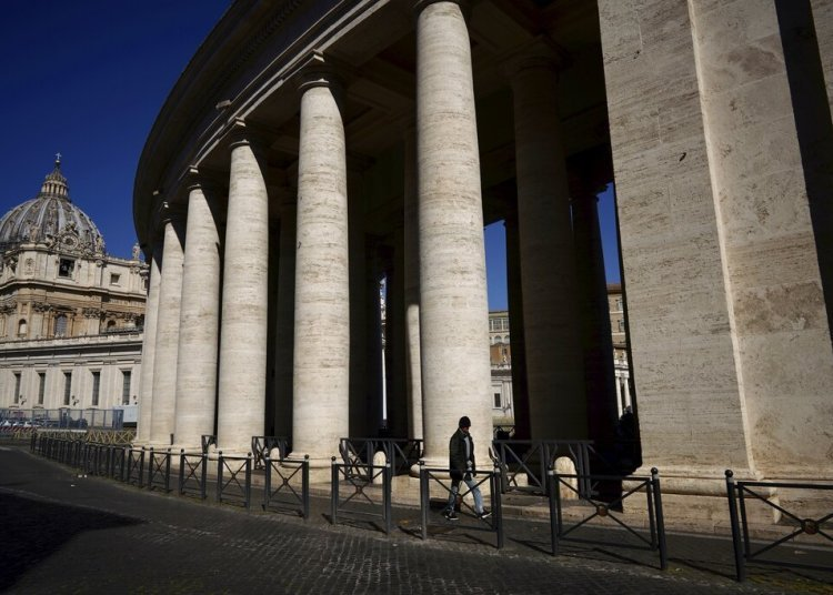A man walks past Bernini's colonnade in St. Peter's Square during Pope Francis' weekly appearance that the Vatican is broadcasting online due to restrictions against the new coronavirus. Photo: AP / Andrew Medichini.
