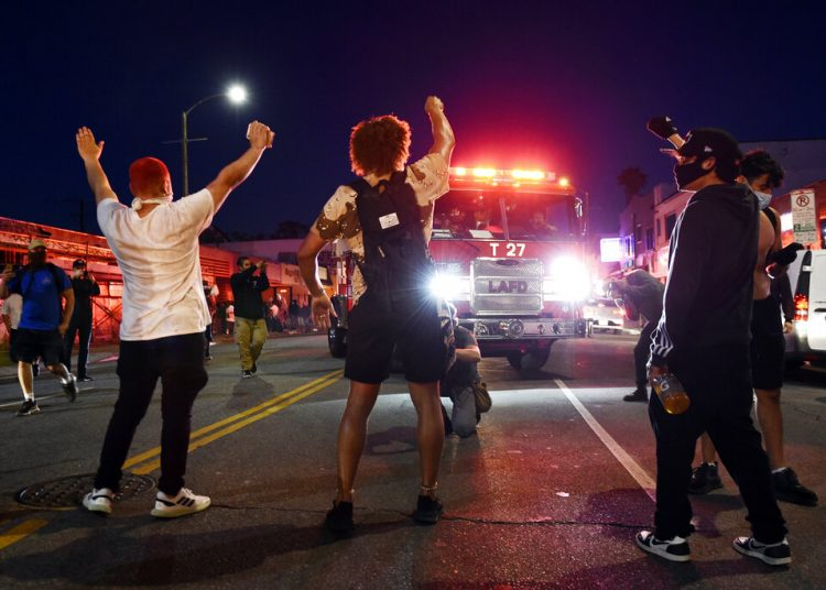 Protesters blocking the path of a Los Angeles fire truck during riots on Melrose Avenue on Saturday, May 30, 2020. Photo: Chris Pizzello/AP