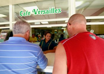Two clients have coffee at the Versailles window in Little Havana. Photo: Rui Ferreira.