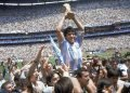 In this June 29, 1986 photo, Maradona raises the World Cup after Argentina's 3-2 victory over Germany in the finals. Photo/Carlo Fumagalli, archive).