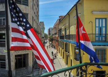 Cuban and U.S. flags on the facade of the La Moneda Cubana Restaurant in Havana. Photo: Yamil Lage/AFP/Getty Images.