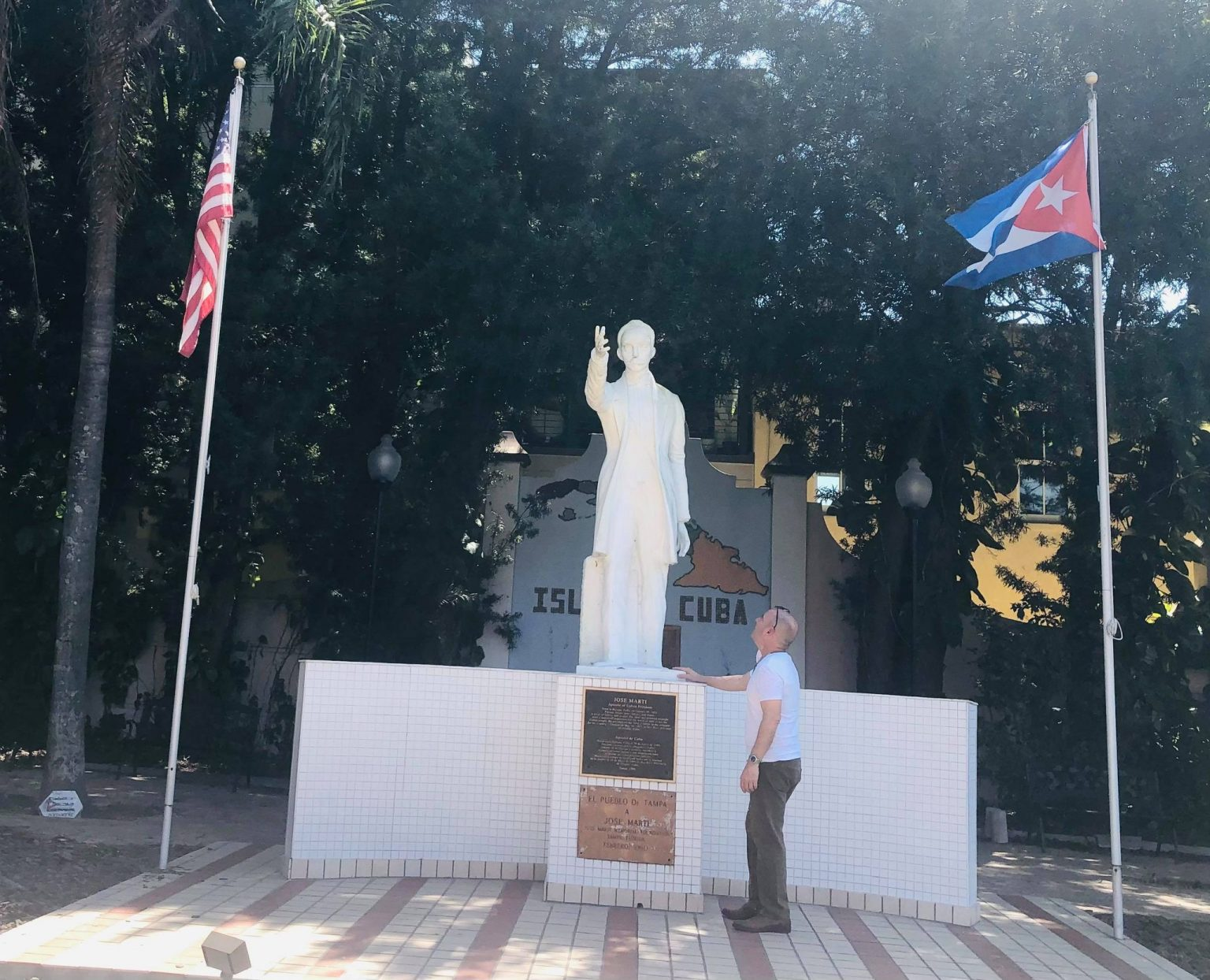 The Cuban-American teacher Carlos Lazo in front of the monument to José Martí in Ybor City, Tampa.