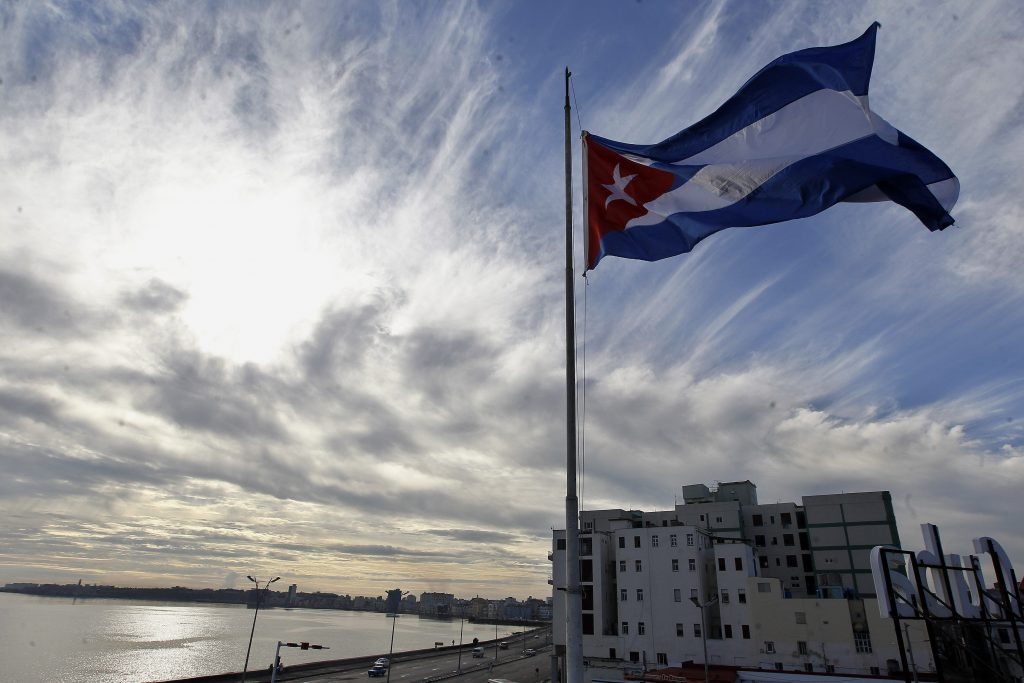 The Cuban flag is flying at half mast today in homage to the victims of yesterday's plane accident in which 108 persons died. Photo: Ernesto Mastrascusa / EFE.