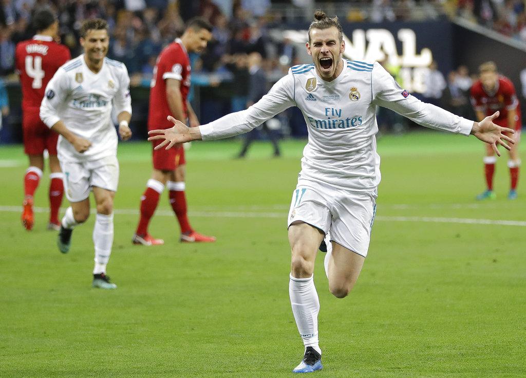Gareth Bale festeja tras anotar el segundo gol del Real Madrid en la final de la Liga de Campeones ante Liverpool en Kiev, Ucrania, el sábado 26 de mayo de 2018. (AP Foto/Sergei Grits)