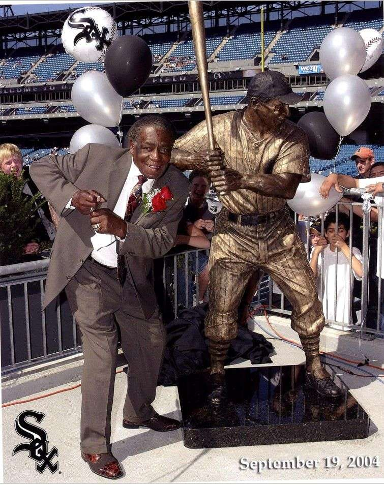 Minoso by the statue dedicated to him at the stadium US Cellular Field
