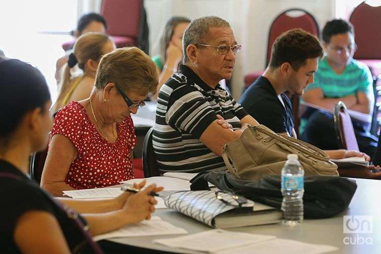 Immigrants who arrived recently from Cuba attend an orientation session at Kentucky Refugee Ministries in Louisville