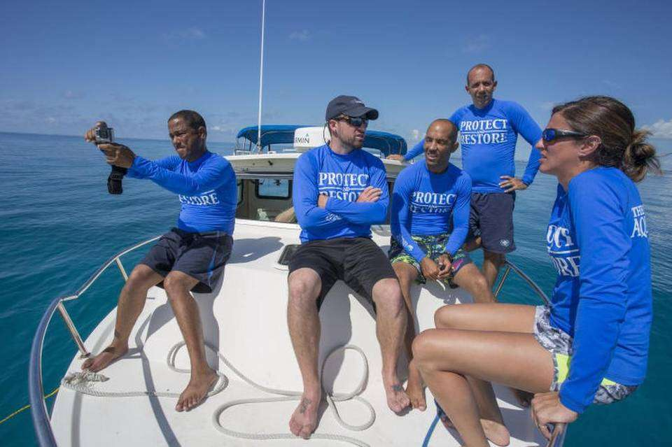 Hanzel Caballero, Pedro Chevalier and Alexis Osoria from the National Aquarium of Cuba; Shawn Garner and Lauren DeLuca from the Florida Aquarium, on August 21, 2016, while waiting for the divers to bring up staghorn coral. Photo: John Pendygraft / Tampa Bay Times.