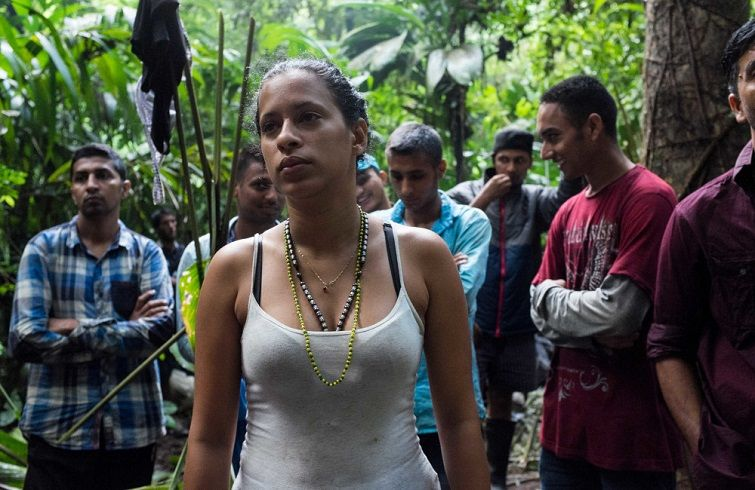 Liset at dawn in the Darien Gap, she and Marta are the only women in a group of some 50 migrants and coyotes. Photo: Lisette Poole.
