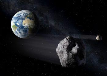 Recreación digital del paso de dos asteroides junto a la Tierra. Imagen: esmateria.com