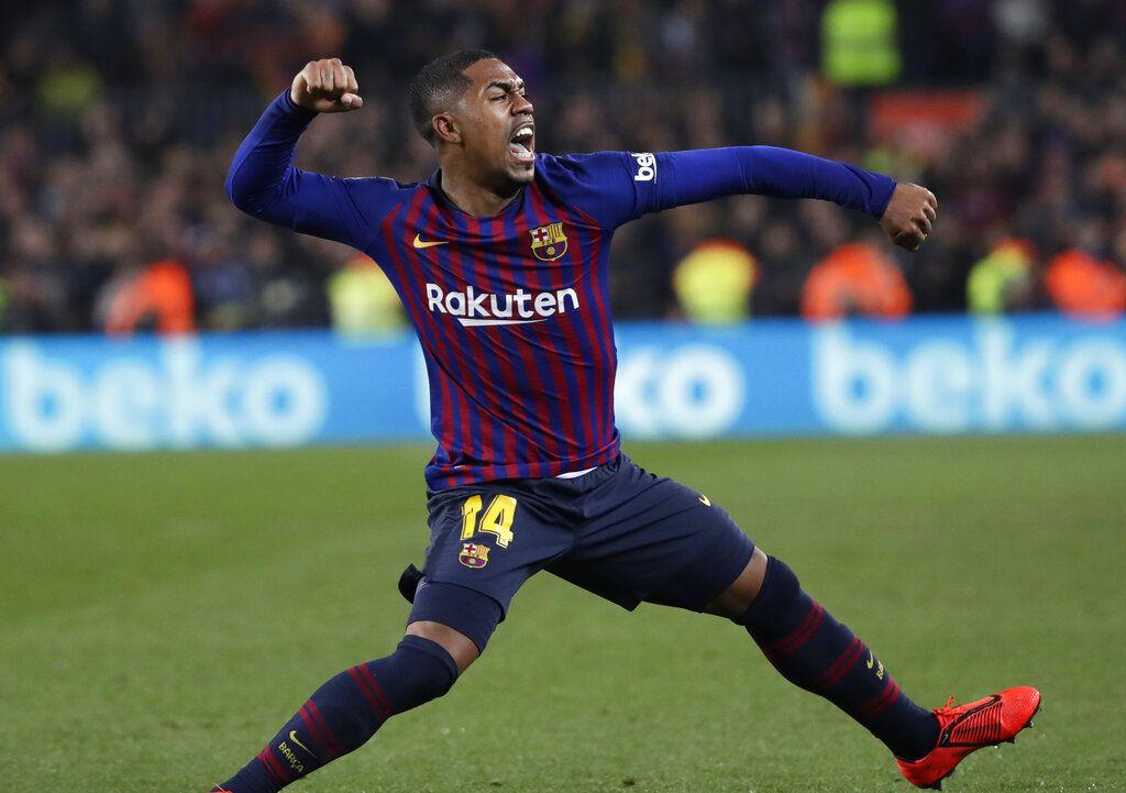 Malcom festeja tras anotar el primer gol del Barcelona ante Real Madrid en la semifinal de la Copa del Rey en el estadio Camp Nou del Barcelona, el miércoles 6 de febrero de 2019. (AP Foto/Emilio Morenatti)
