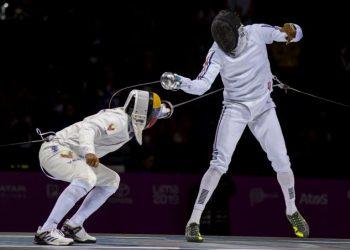 Yunior Reytor (d) combate en las semifinales de los Panamericanos de Lima contra el venezolano Rubén Limardo, titular de los Juegos de Londres 2012. Foto: www.granma.cu / Archivo.