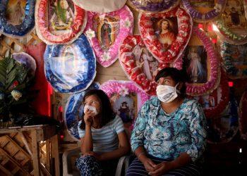 Una vendedora popular y su hija en Ciudad México. Foto: Business Insider.